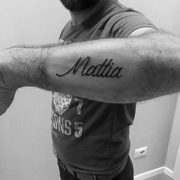 name on forearm tattoo