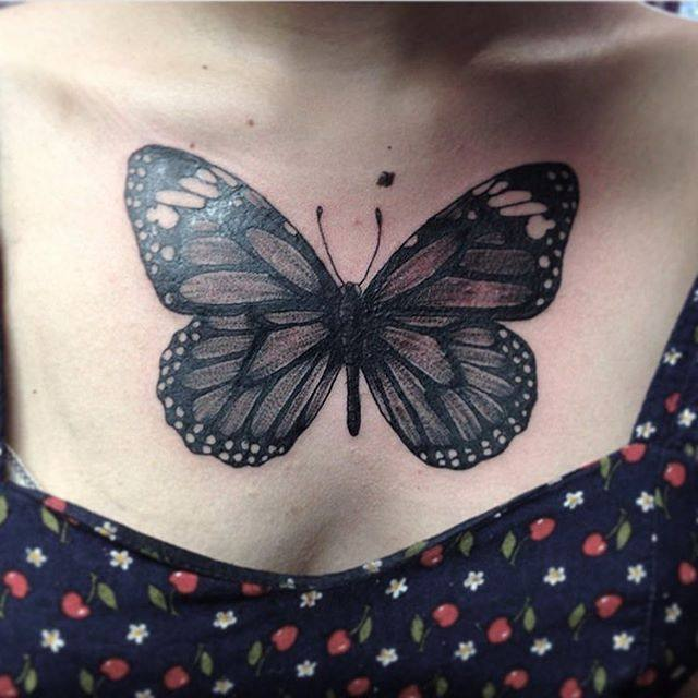 butterfly chest tattoo female