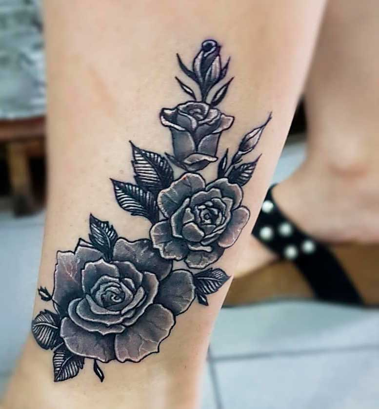 big rose tattoo on leg