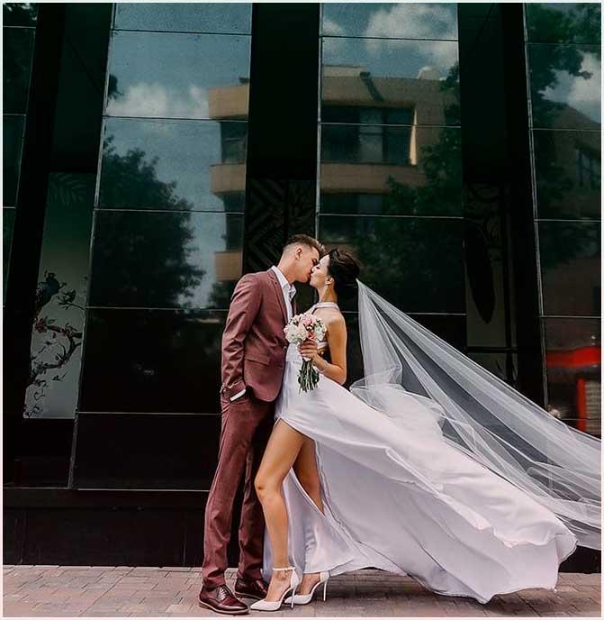 creative wedding photos on the street for couple